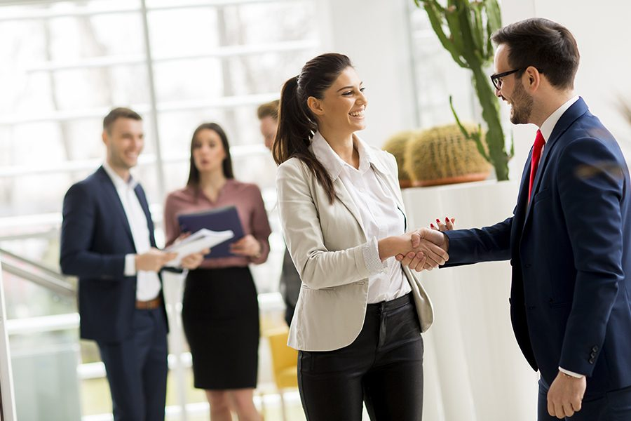 Our Business Partners - Business Partners Shaking Hands in a Modern Office
