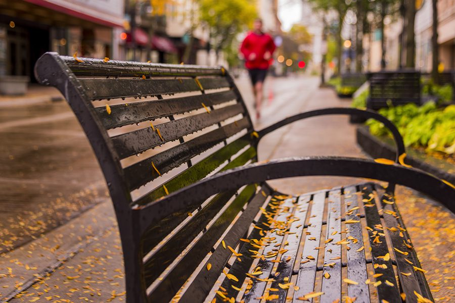 Beloit, WI - Rain Covered Bench on a Street in Wisconsin