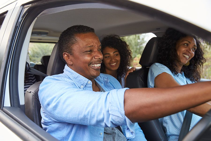 Blog - Happy Father And Daughters Driving In Car