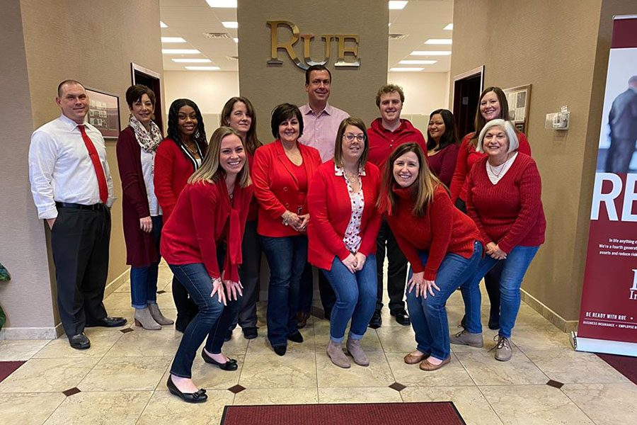 About Our Agency - Rue Insurance Team Celebrating Heart Health Awareness Month in the Office