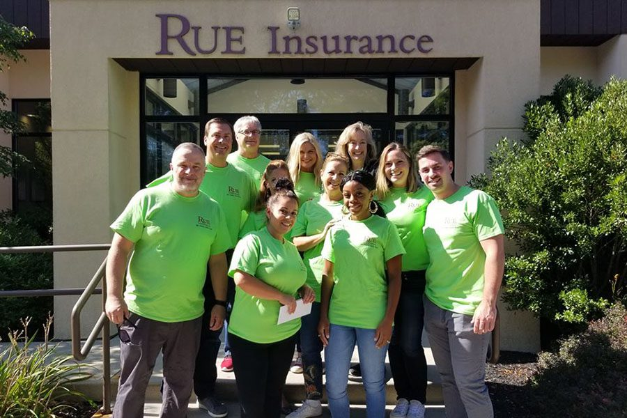 About Our Agency - View of Rue Insurance Team Standing Outside Office Building