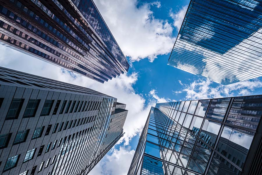 Small Business Insurance - View of Tall Skyscrapers Against Blue Sky in the City
