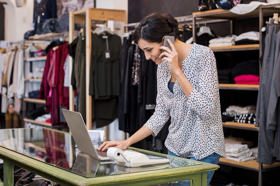 Retail Small Business Insurance - Woman Shop Owner on the Phone About an Order