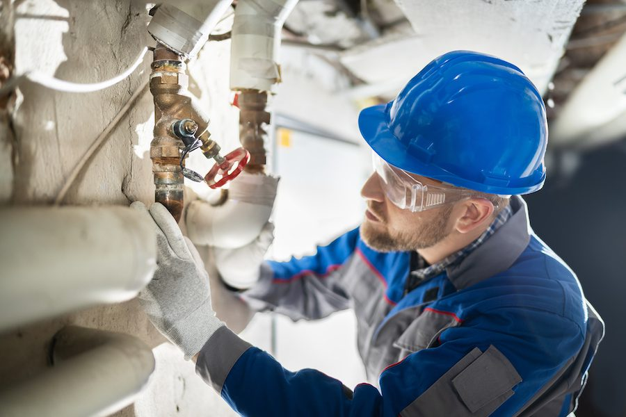 Contractors for Heating, Air Conditioning, Mechanical & Plumbing (CHAMP) - Male Worker Inspecting Valve