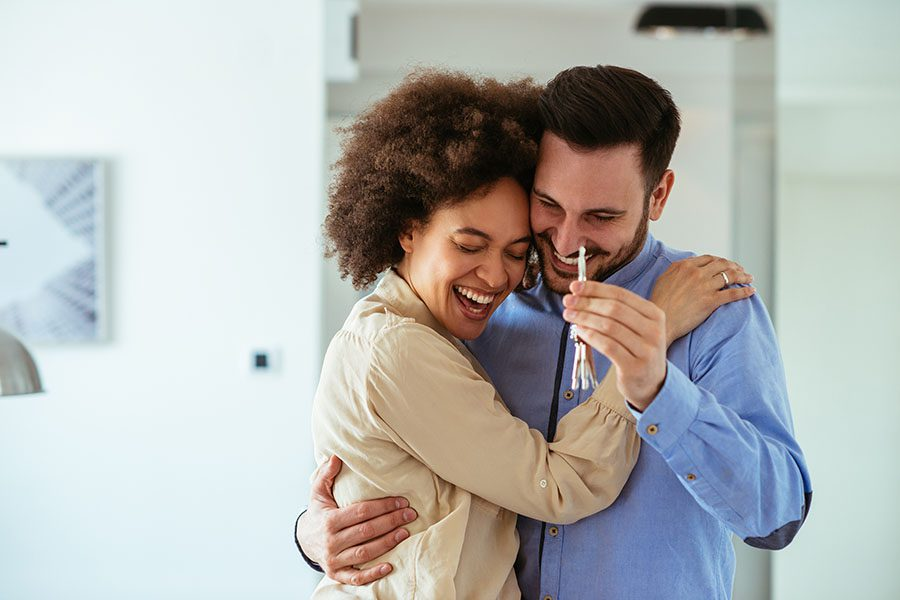 Personal Insurance - Excited Couple Celebrating the Purchase of Their New Home