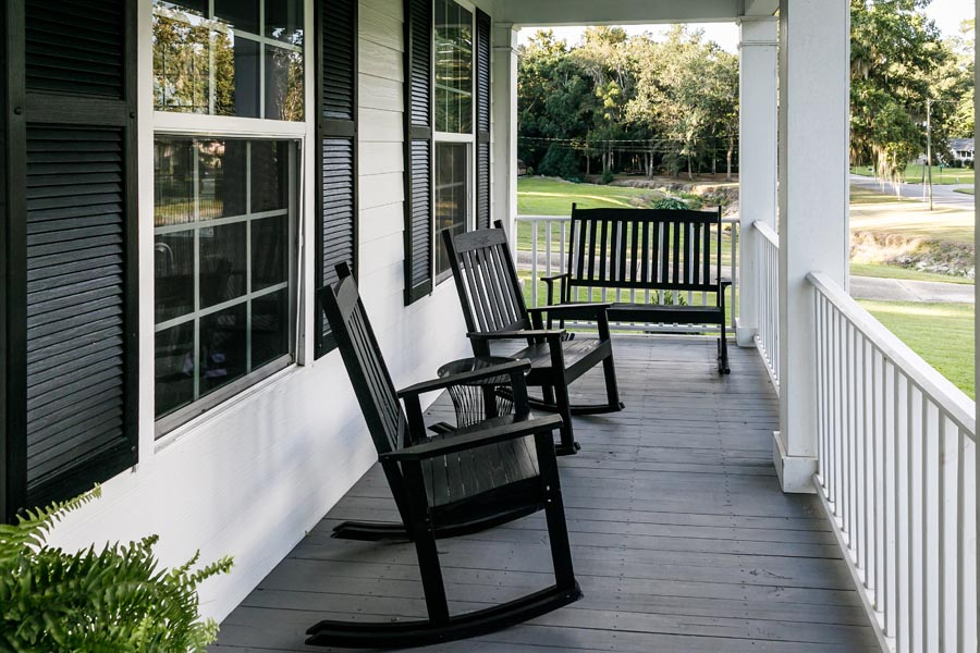Brentwood, TN Insurance - View of a Front Porch with Black Rocking Chairs