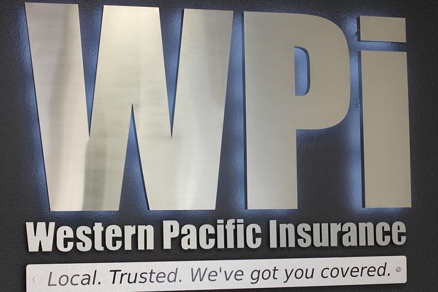 Office Tour - Metallic WPI Company Sign Stating Western Pacific Insurance, Local, Trusted, We've Got You Covered