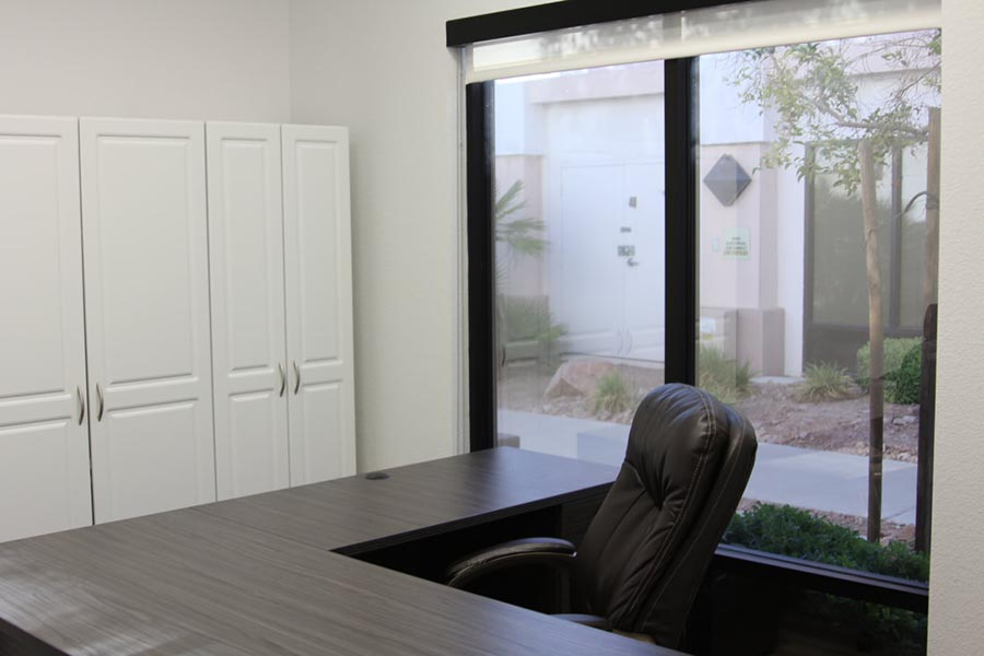 Office Tour - Reception Area with Large Desk, Chair, Large Window Overlooking Landscaped Area