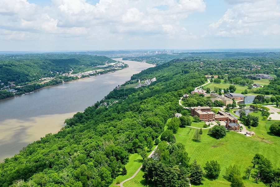 Portsmouth, OH Insurance - Aerial View of the Ohio River on a Sunny Day, Green Trees Lining the River