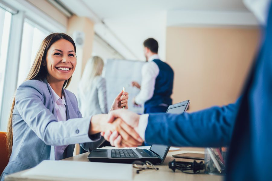 Refer an Agency - Handshake Over a Business Meeting in an Office