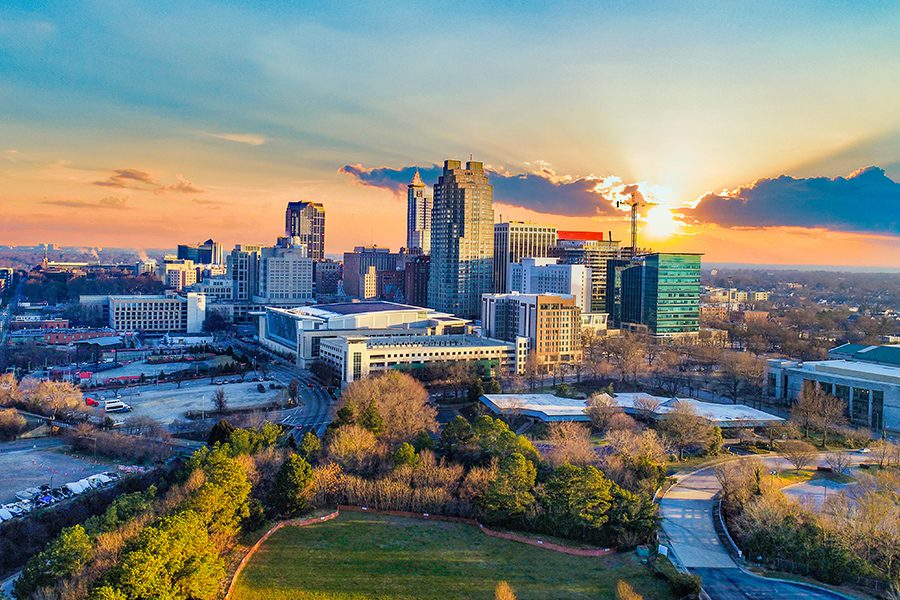 Contact - Aerial View of Downtown Raleigh, North Carolina Skyline at Sunset