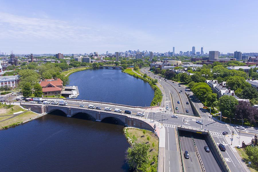 Medford, MA Insurance - Aerial View of the Charles River and Surrounding Suburbs and Highways With Boston in the Distance