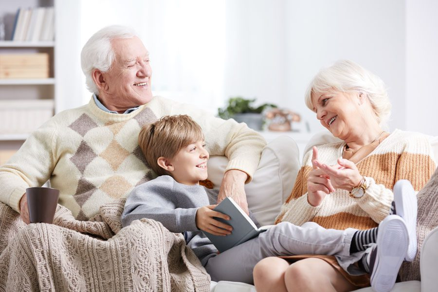 Individual Retirement Accounts - Grandparents with Grandchild on the Couch