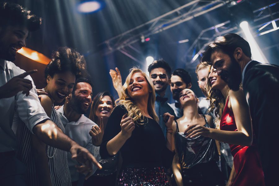 Nightclub and Bar Insurance - Friends Dancing at a Club and Having Fun