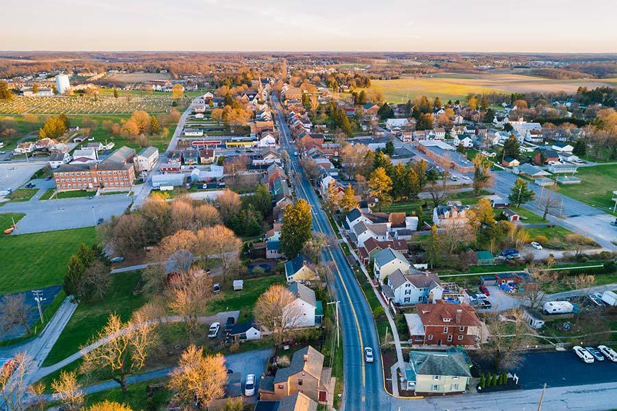 Murray KY - Aerial View of Small Town Murray Kentucky at Sunset with Views of Homes and Commercial Buildings