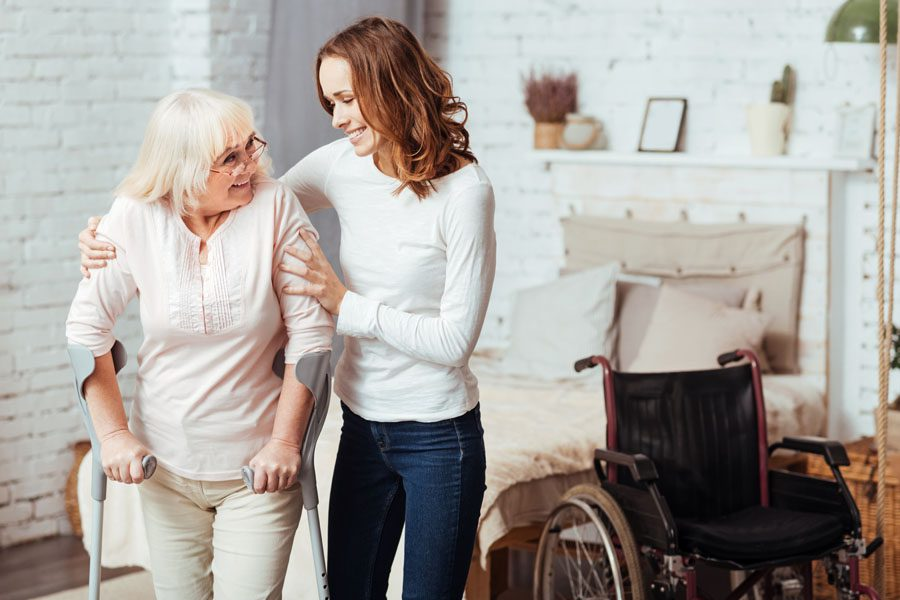 Disability Insurance - Daughter and Mother Learning How to Walk Again