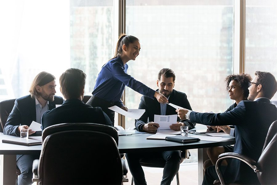 Request Group Benefits ID Card - Business Woman Handing Out Papers During Business Meeting in the Office