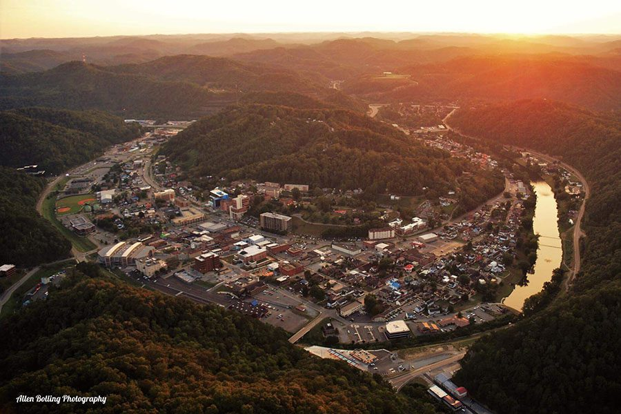 Pikeville, KY - Aerial View of the City of Pikeville Kentucky Surrounded by Hills at Sunset