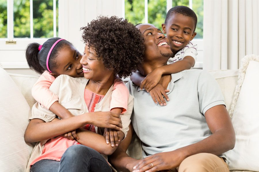 Excess Liability Insurance - Family Looking Lovingly at their Children