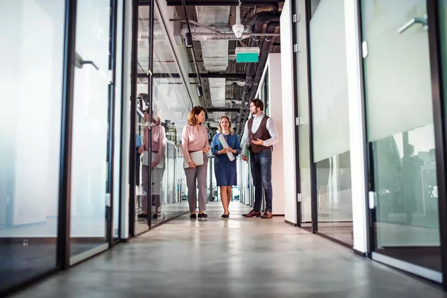 General-Liability-Office-Hallway-of-Employees-Standing-and-Chatting