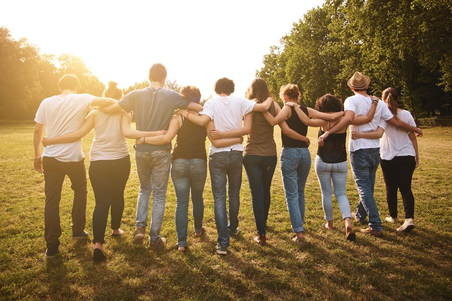 Community-Involvement-Group-of-Friends-Embracing-After-a-Long-Day-of-Community-Service