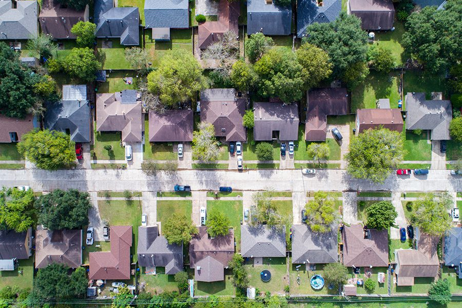 Texas Insurance - Aerial View of Residential Home Community in Texas Suburb
