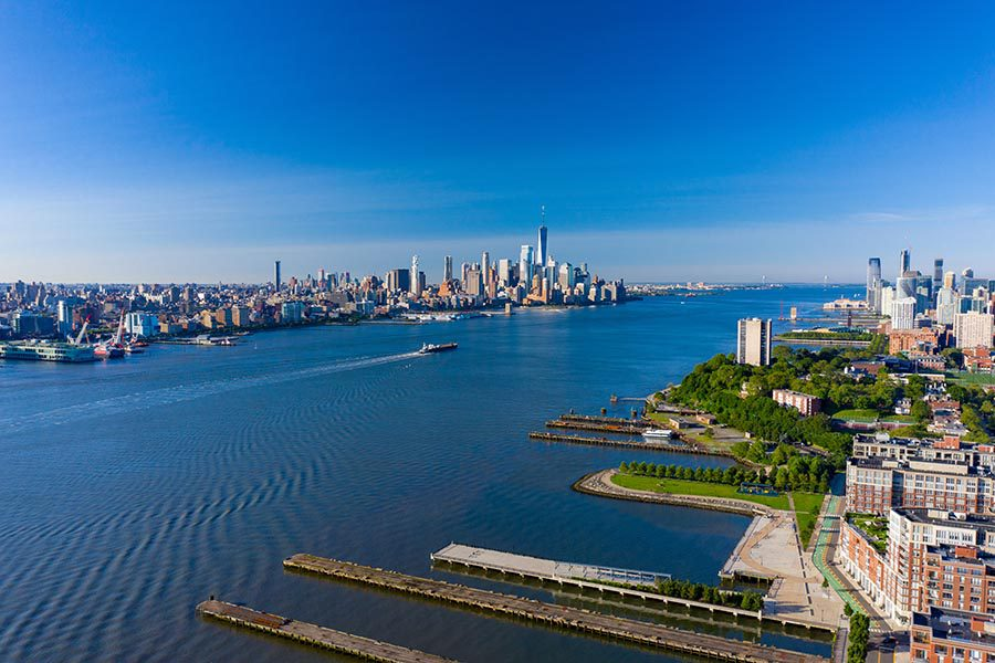 Union City Insurance - Aerial View of New Jersey, the Hudson River, and Manhattan, on a Sunny Cloudless Day