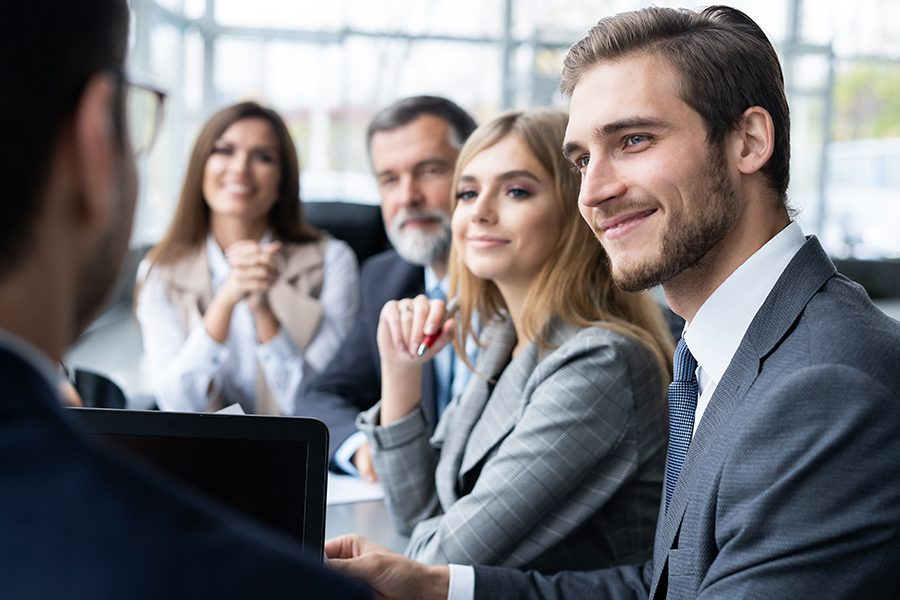 Principles - Closeup of Business Team and Manager Sitting at a Conference Table During a Meeting