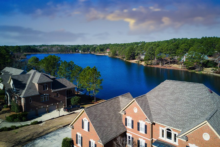 Boone, NC - Aerial View of Large North Carolina Homes by the Lake in the Evening