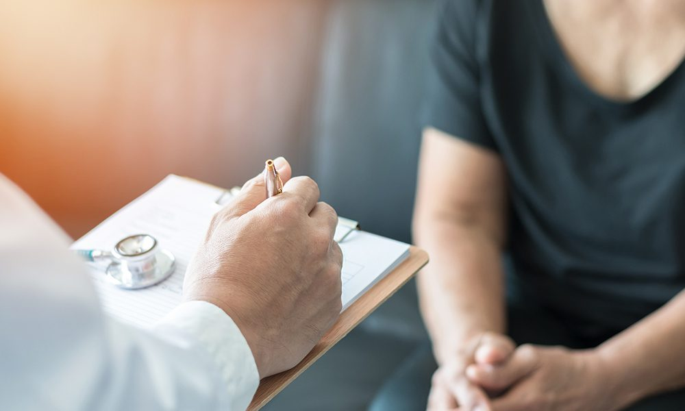 Blog - Doctor Talking with Patient About a Diagnosis in the Office
