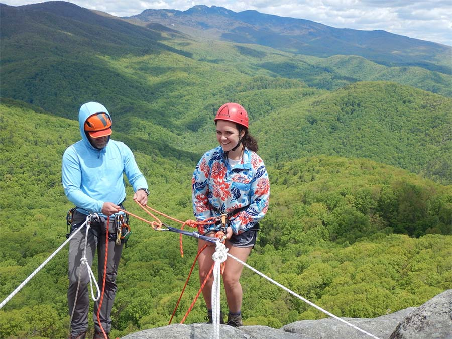 Blog - Gym to Crag Risk Management with Granite Insurance - Appalachian Mountain Leadership Helping Student At The Top Of The Climbing Rock
