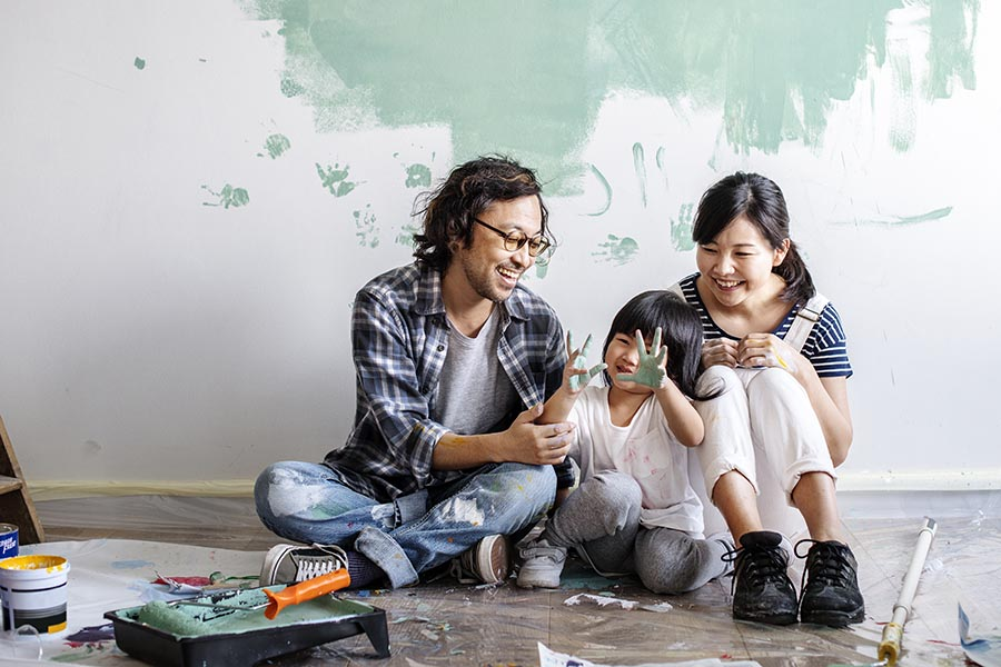 Personal Insurance - Father, Young Daughter and Mother Sit on the Floor Surrounded by Painting Supplies, Little Girl Showing Her Paint-Covered Hands