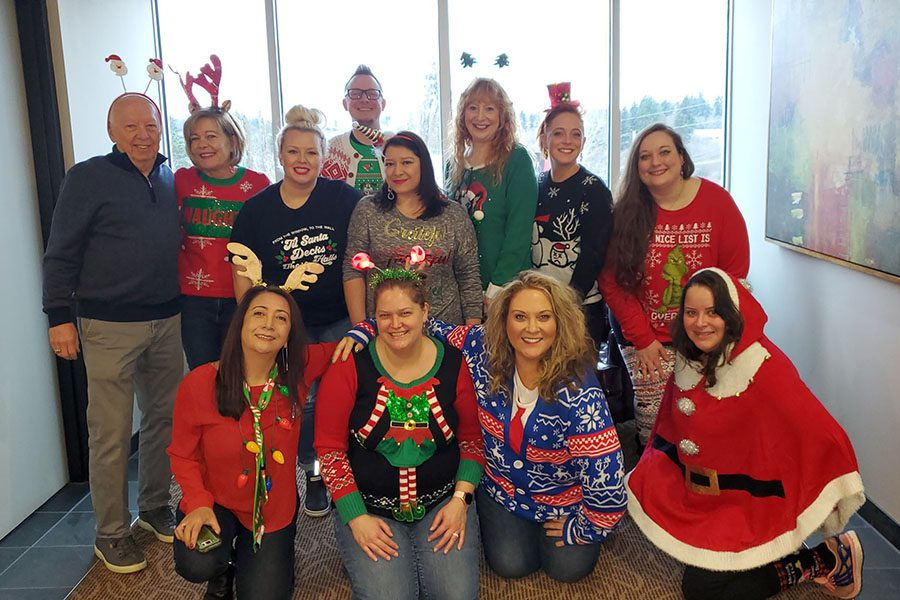 About Our Agency - Portrait of Mosaic Insurance Staff During Christmas Holiday Party in the Office