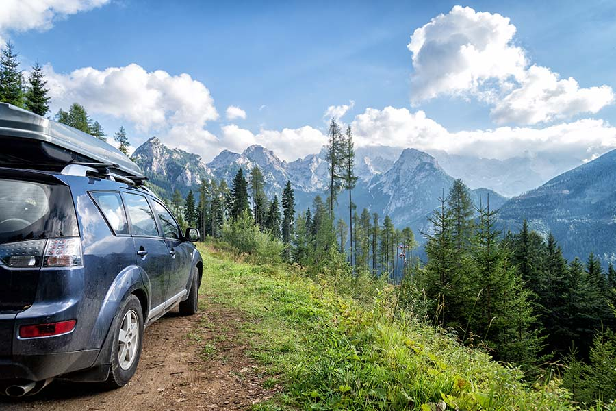 Auto Insurance - Modern Car Parked in Scenic Overlook with Views of the Pacific Northwest Mountains and Forests
