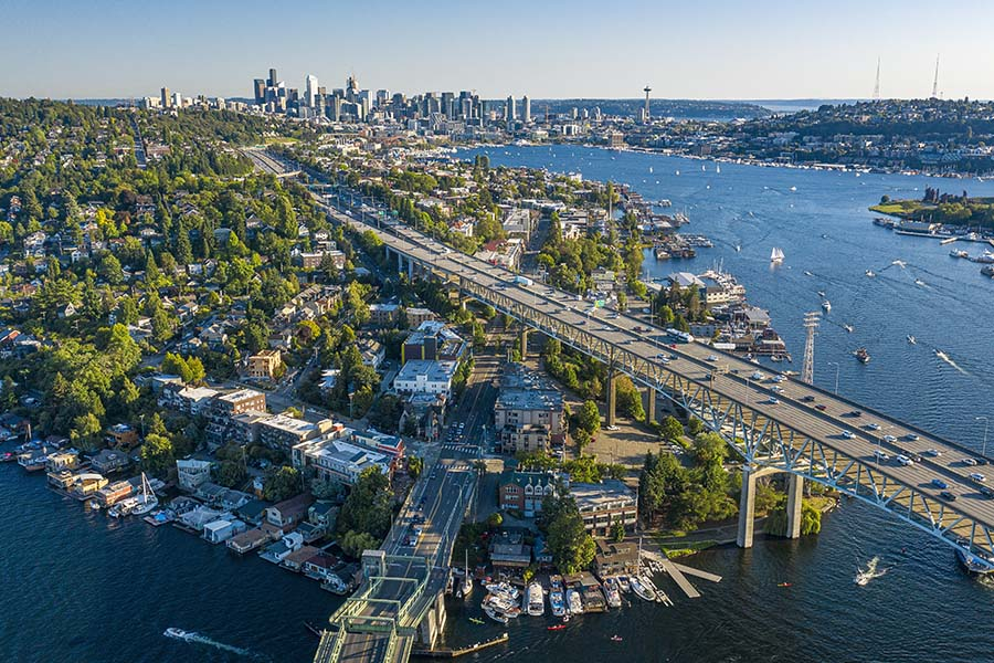 COVID-19 Information - Aerial View of Bridge Crossing the River to Seattle Washington with View of the City in the Background