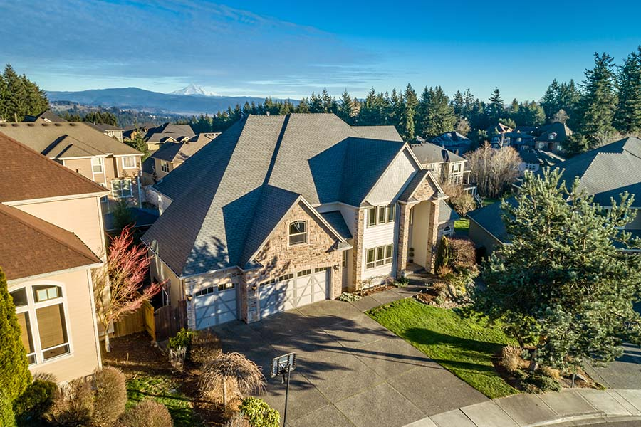 Home Insurance - View of a Luxury Two Story Home with Attached Two Car Garage in Washington