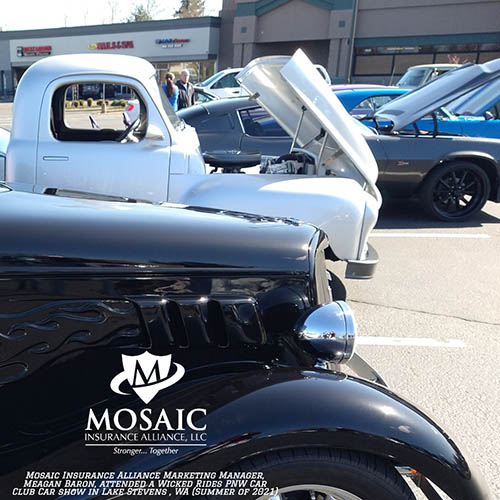 Blog - Classic Auto Insurance, Black Classic Car and White Classic Car with Hood Open and More Classic Cars in Background in Lynnwood Washington with Mosaic Insurance Alliance