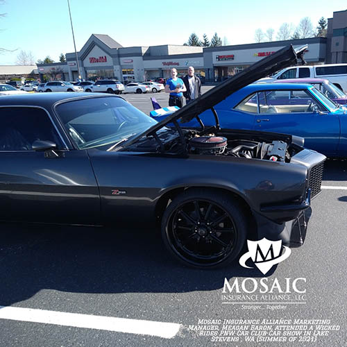 Blog - Classic Auto Insurance, Black Classic Car with Hood Up with Blue Classic Car in Background in Washington with Mosaic Insurance Alliance