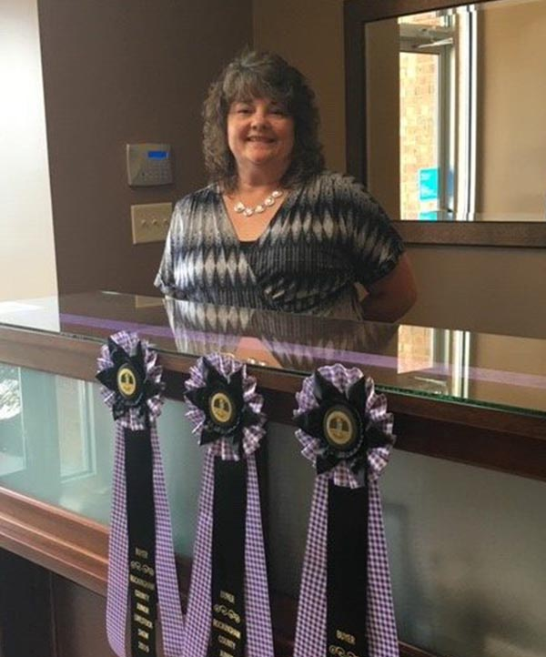 Blue Ridge Insurance Services - Milly Stanley Poses with Fair Ribbons 2019