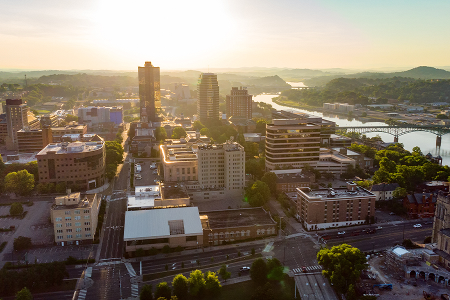 Contact - Aerial View of Downtown Knoxville Tennessee Skyline in the Morning Sunlight