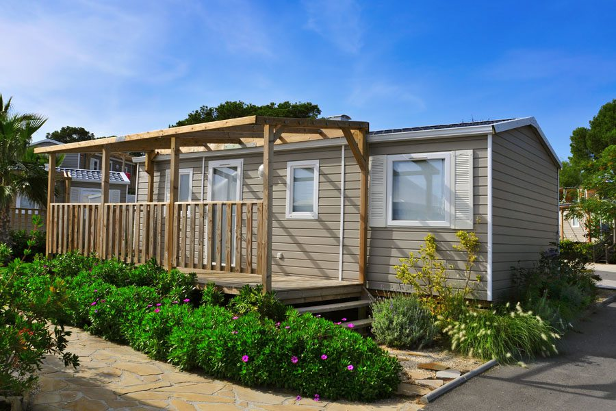 Mobile Home Insurance - Mobile Home with a Garden and Deck