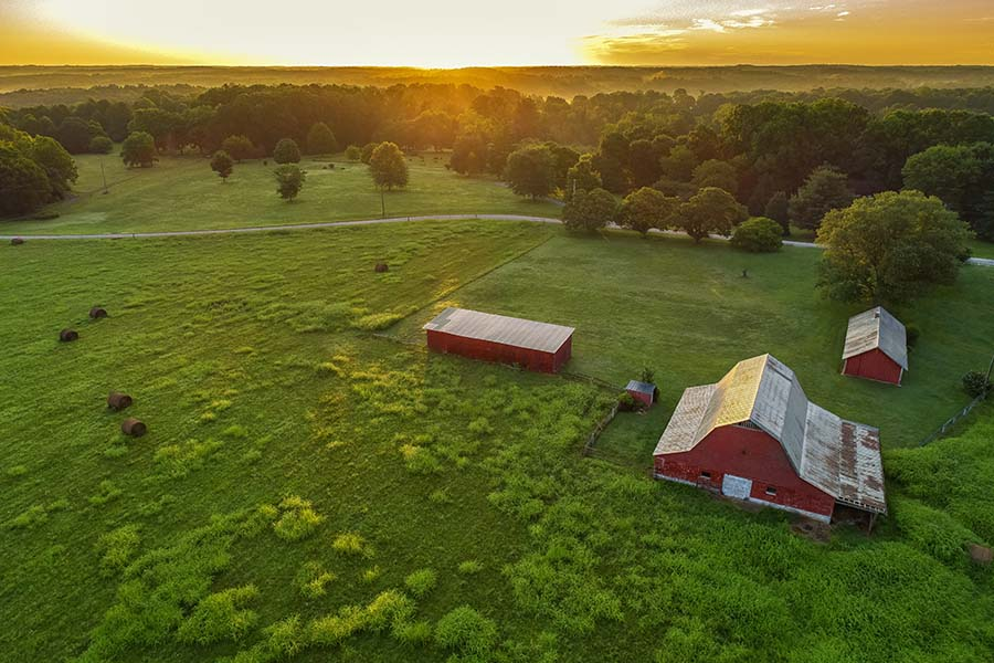 Insurance Quote - View of Farm and Green Fields at Sunset