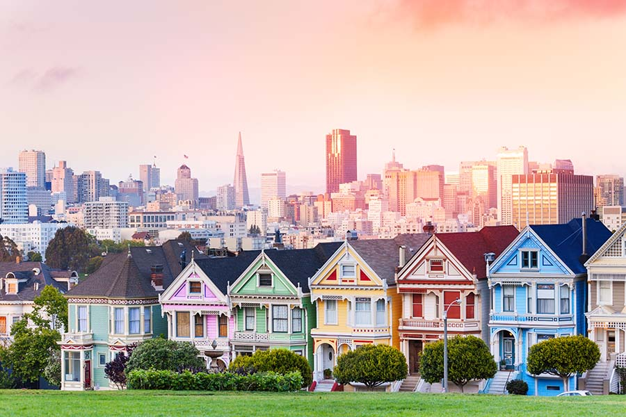 San Francisco CA - San Francisco City Skyline in the Evening with Row of Colorful Homes in the Front