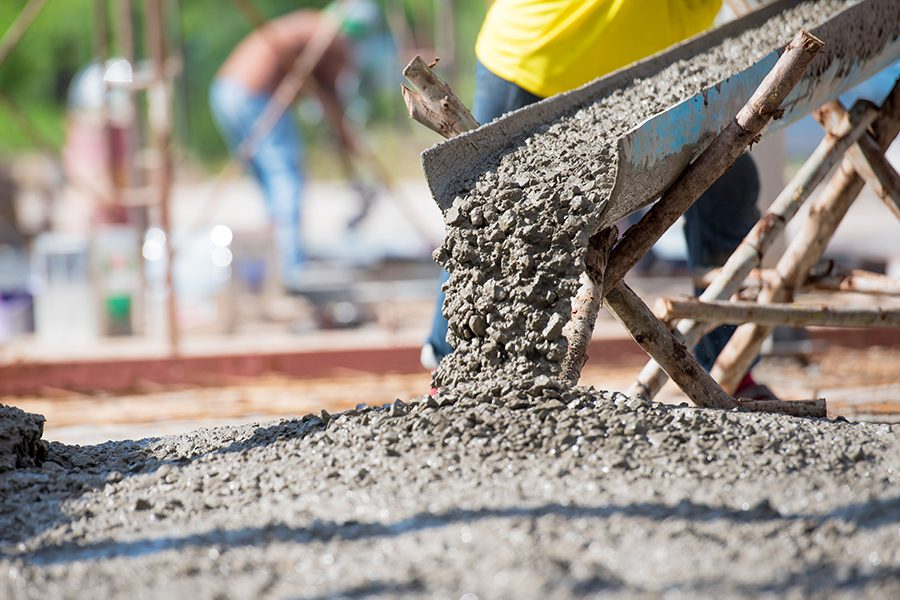 Concrete Contractor Insurance - Selective Focus of Concrete Pouring During Commercial Concreting of Floors for a Building