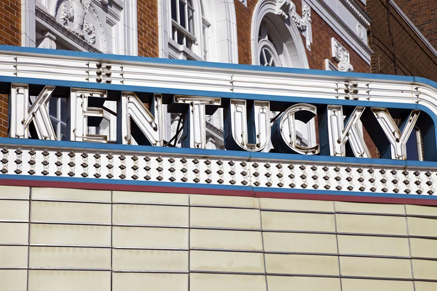 Contact Us - Red, White and Blue Lightbulb Sign Over Theater Reading Kentucky