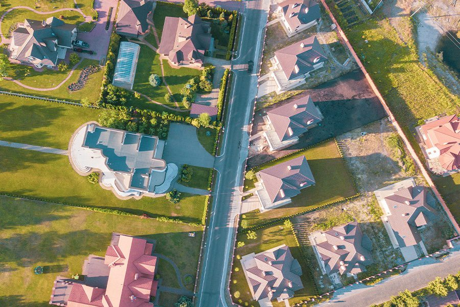 Contact - Aerial Abstract View of a Residential Neighborhood in Cypress, Texas at Sunset
