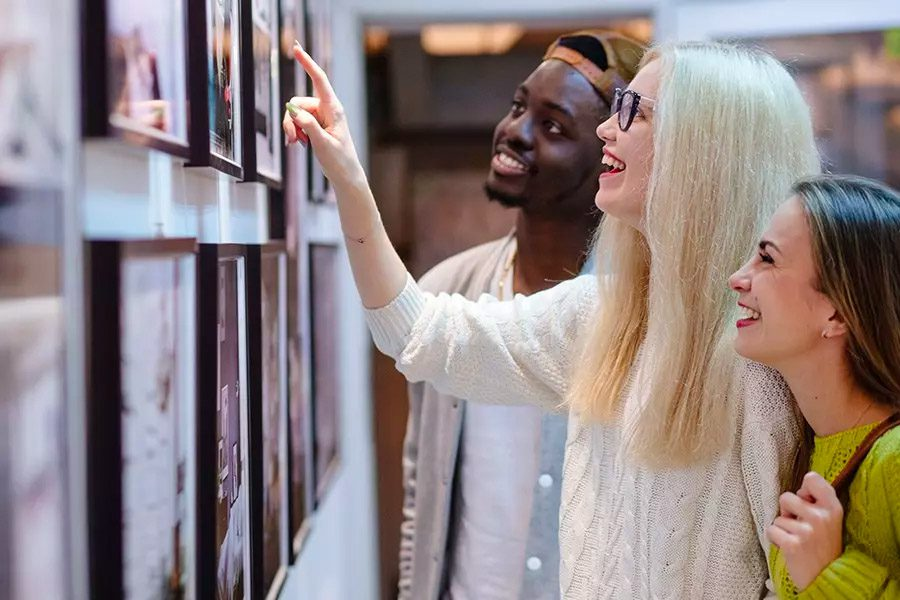 Art-Gallery-Insurance-Three-Young-Students-Looking-at-a-Picture-on-the-Wall-in-an-Art-Photo-Gallery
