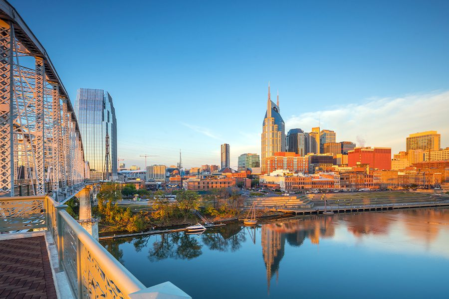 Contact - Nashville, Tennessee Skyline over the Cumberland River on a Sunny Day