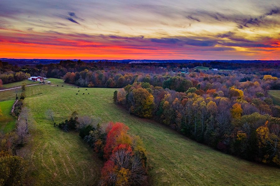 Glasgow, KY - Red Sky and Sunset Over Autumn Forest and Fields Near Glasgow, Kentucky