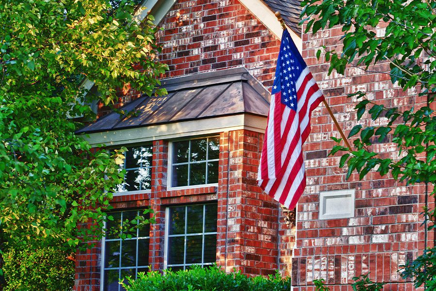 Goodlettsville, TN - Closeup of American Flag Hanging on the Front of a House in Goodlettsville Tennessee